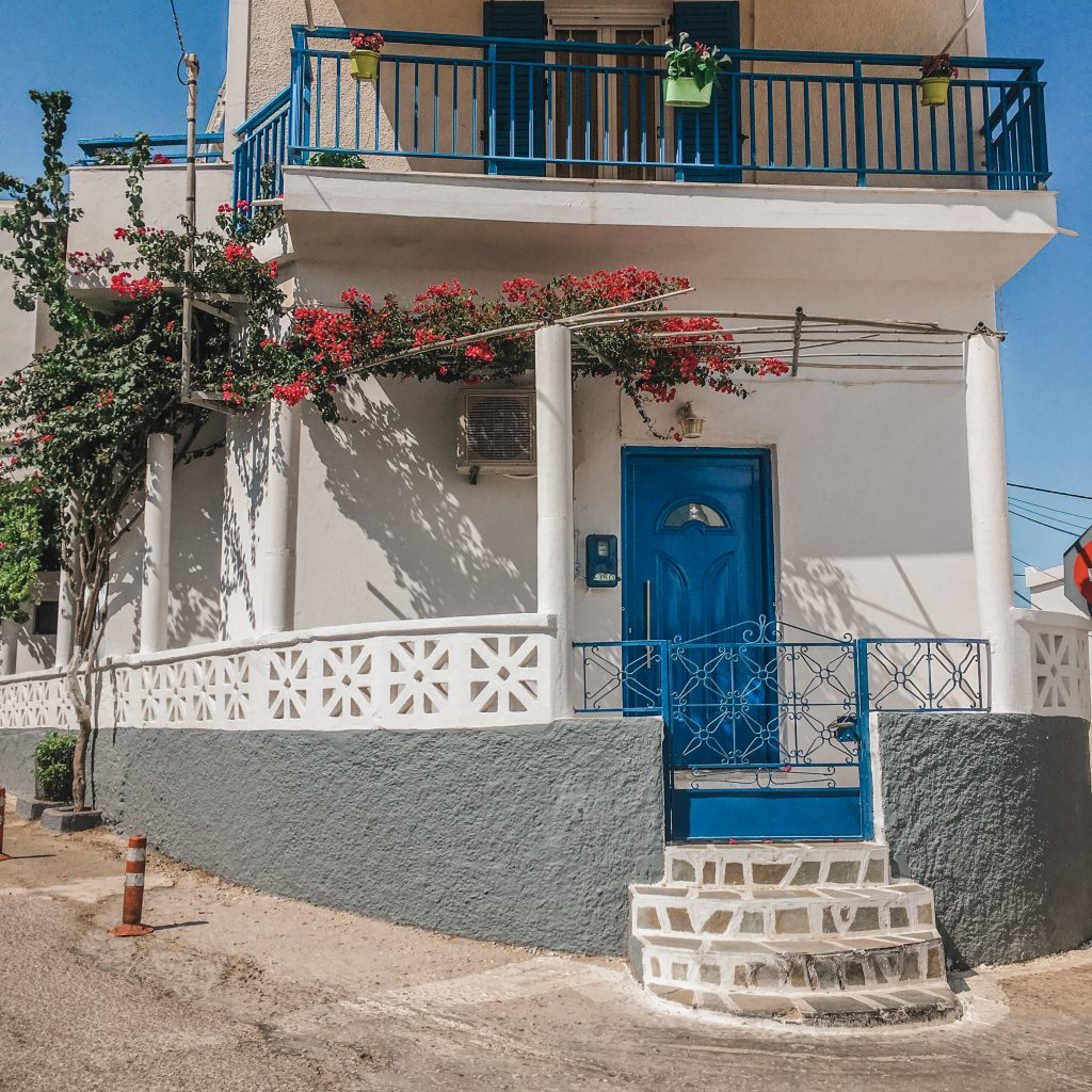 white house with blue doors in greece