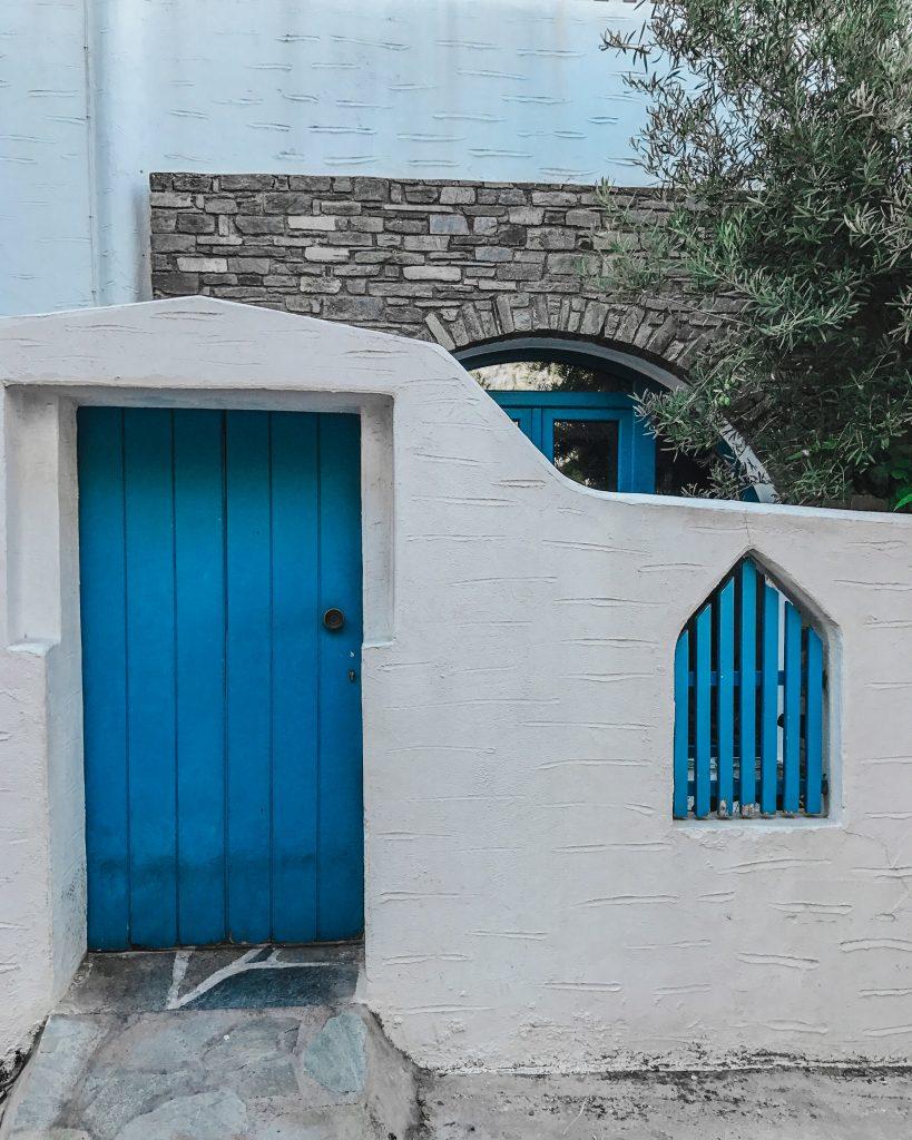 blue door on a white house in mykonos