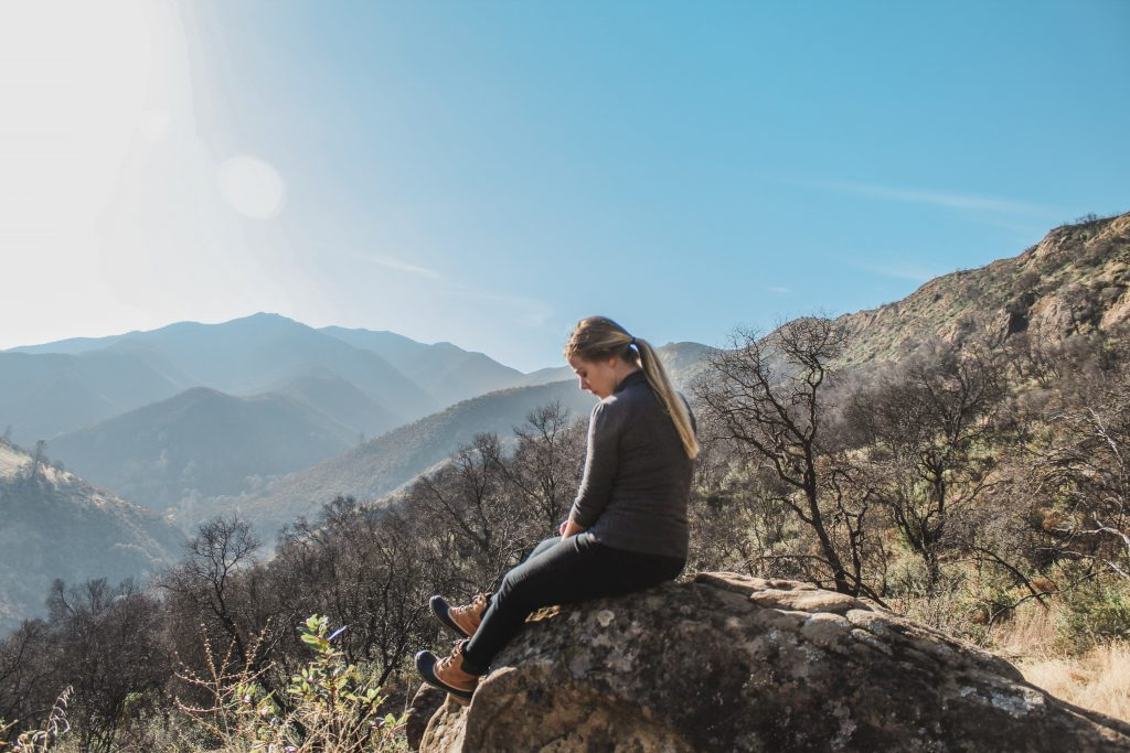 me sitting on a rock looking out over the mountains