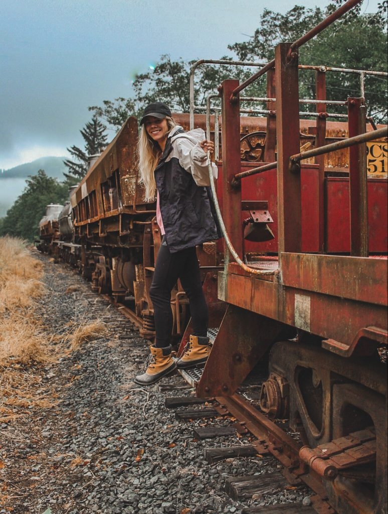 hanging off an old train in garibaldi