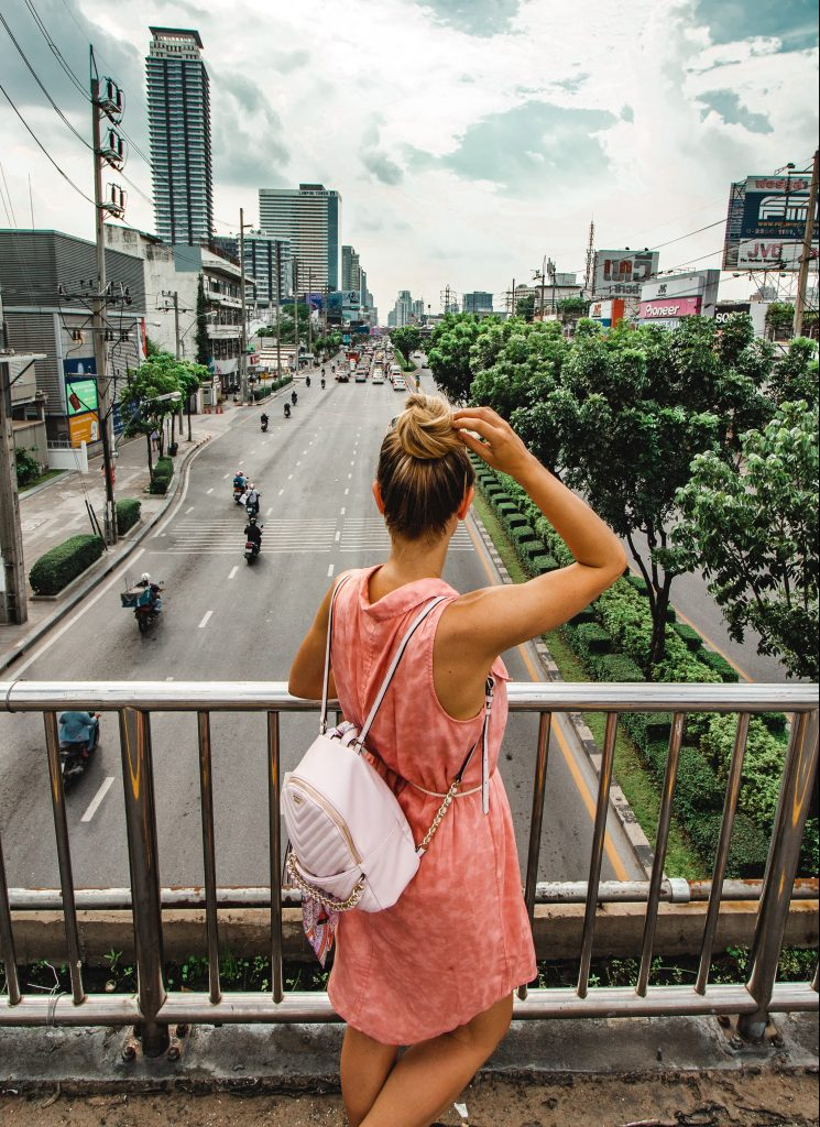 looking over streets of bangkok from elevated walkway