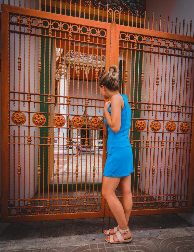 me looking through the red gates of wat pho