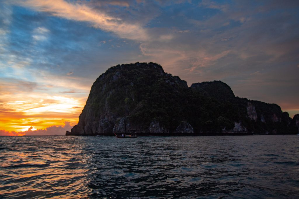 sunset on the phi phi don over the water