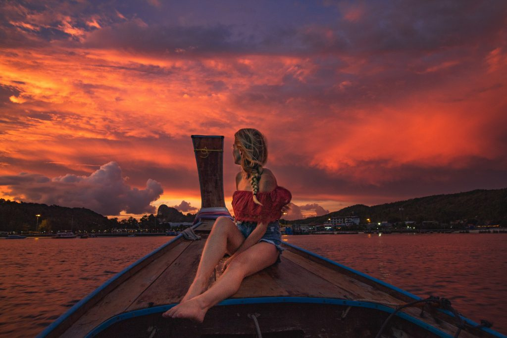 me still on the boat with crazy pink and purple sky