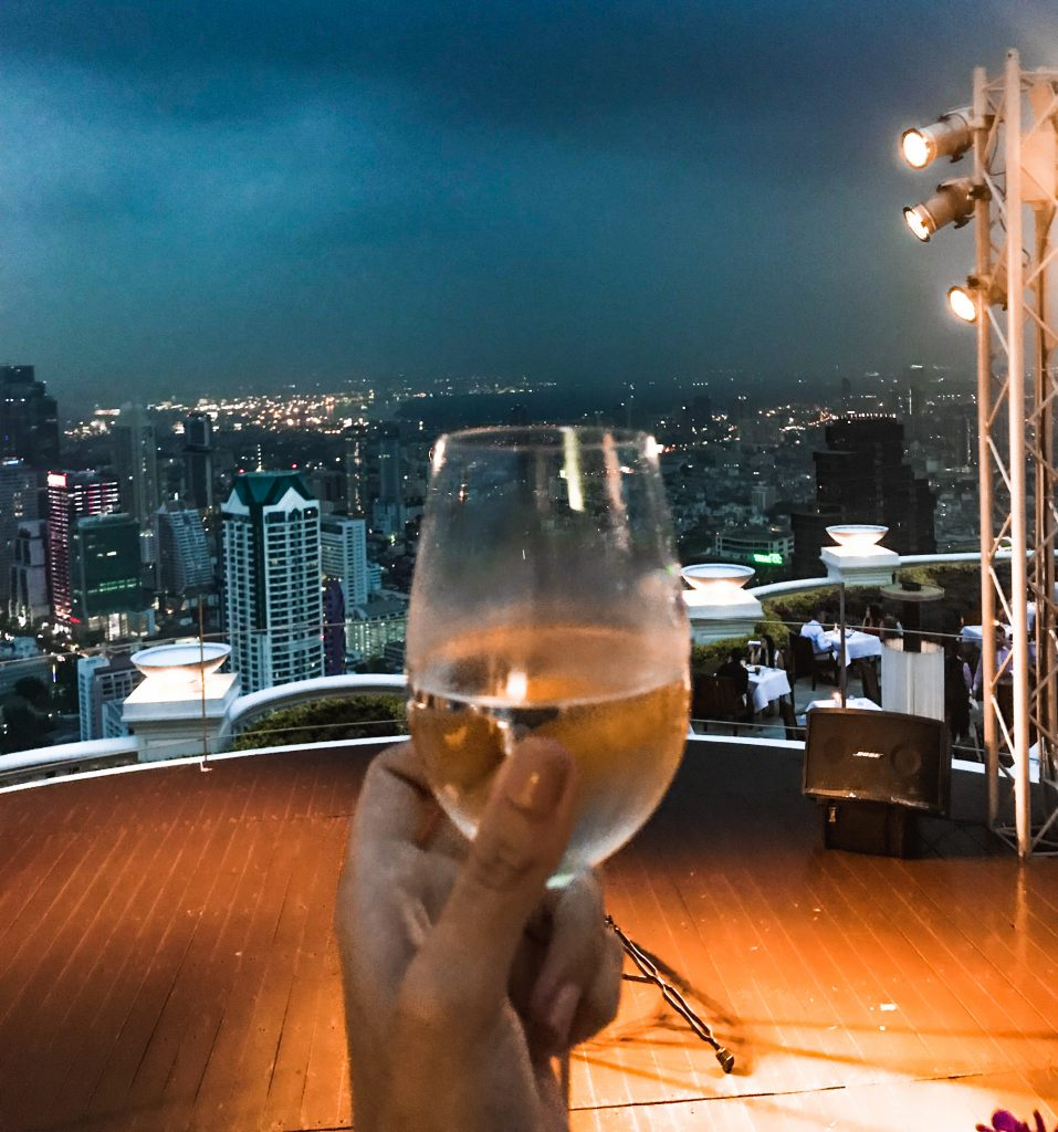 glass of wine from the roof top of lebua