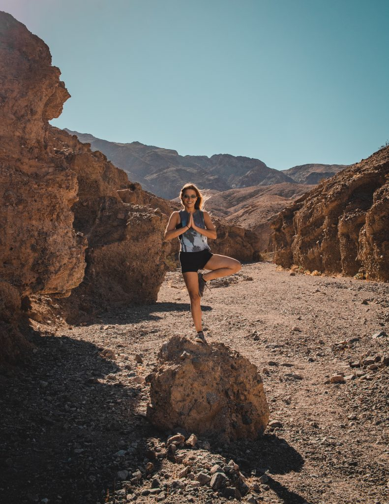 standing on a rock near sidewinder canyon