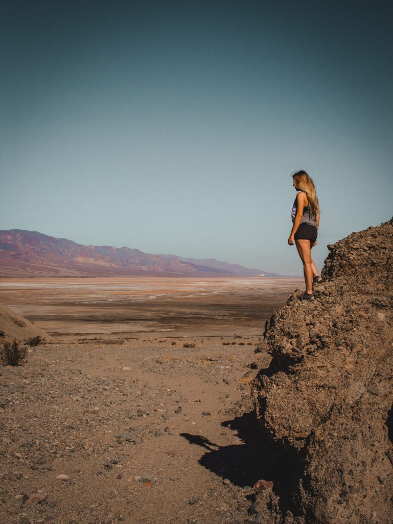 standing on rocks looking out over badwater basin