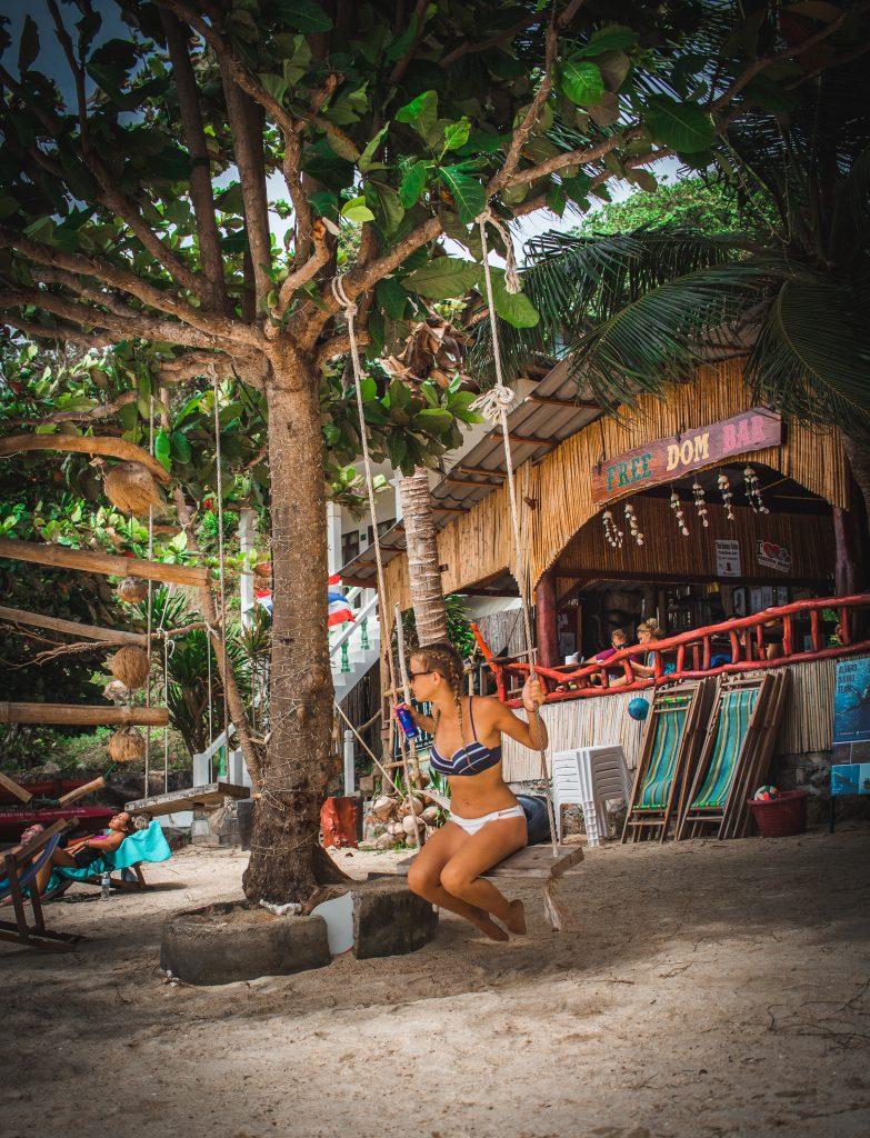 swinging at the freedom beach bar
