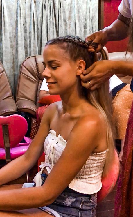 getting my hair braided by a thai woman