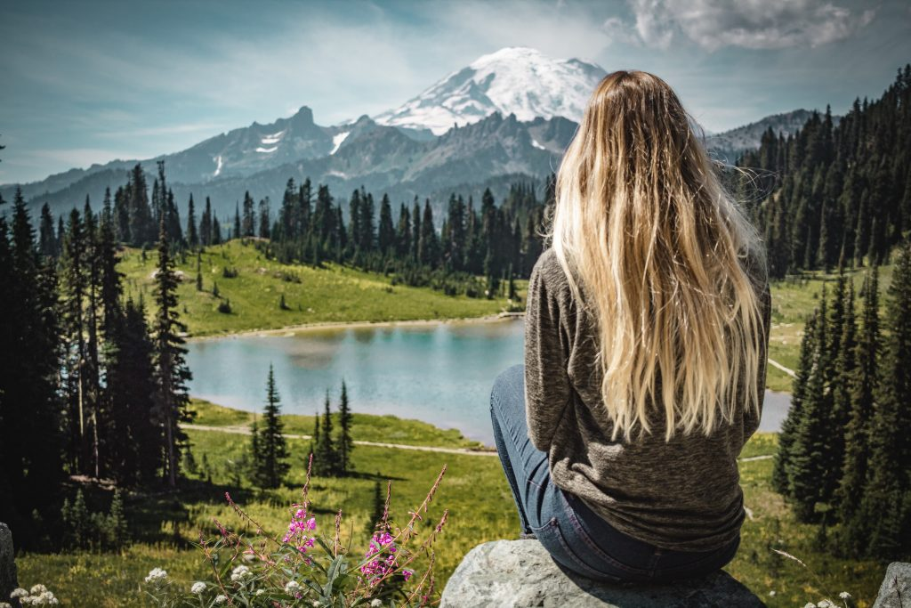 me on a rock in front of mount rainier