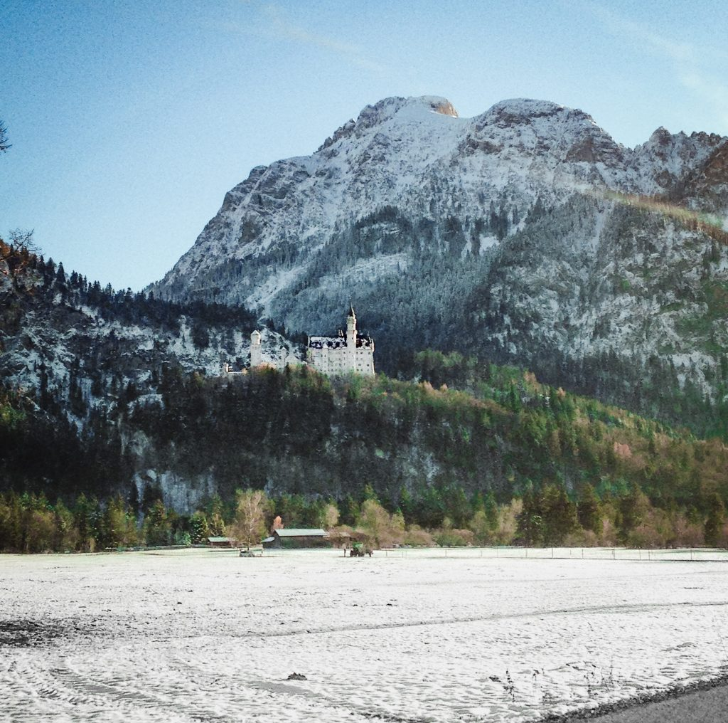 neuschwanstein perched up on the mountains