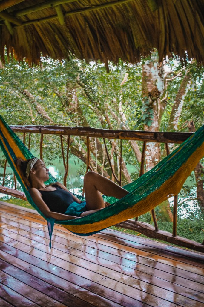 me lounging in a hammock at the lodge