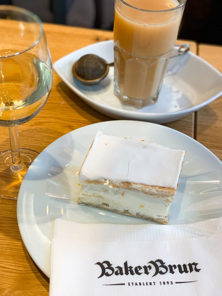 a piece of cake, tea and a glass of wine at baker brun