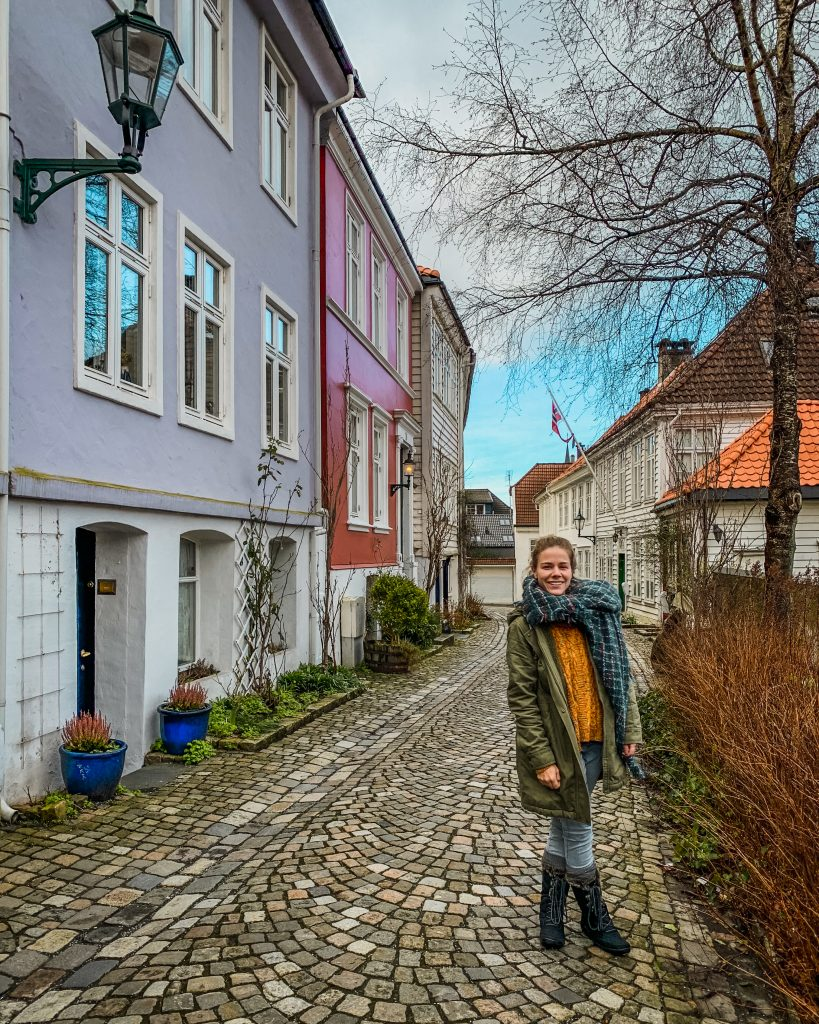 me standing on our cobblestone street in front of the airbnb