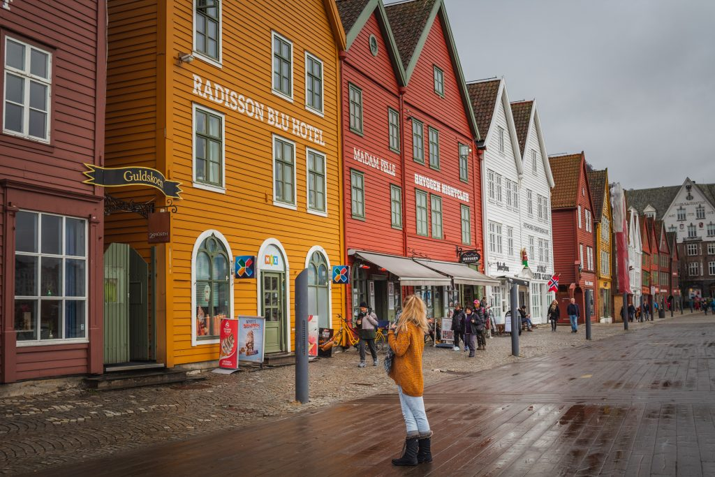 me in front of the colorful buildings of bryggen in bergen