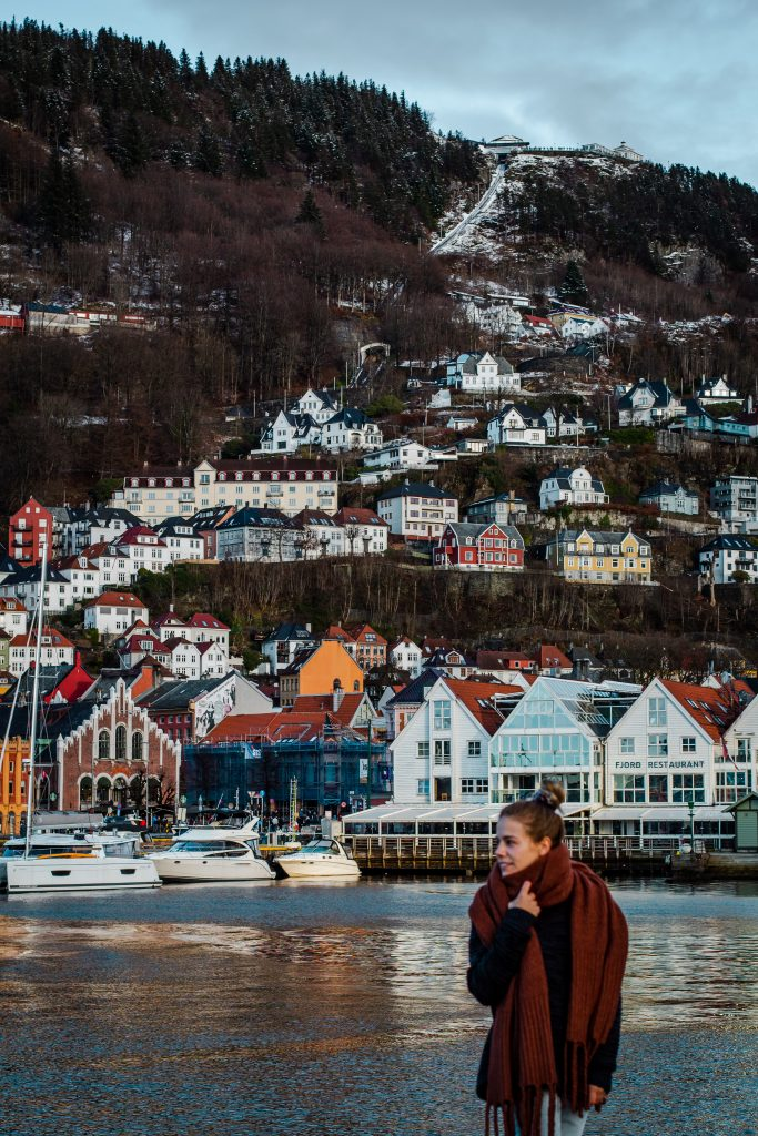 me standing in front of bergen's harbor and houses on the hills