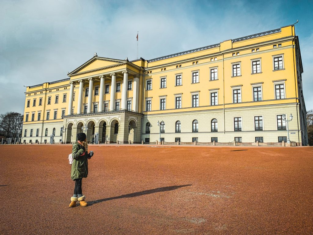 me in front of the yellow colored royal palace