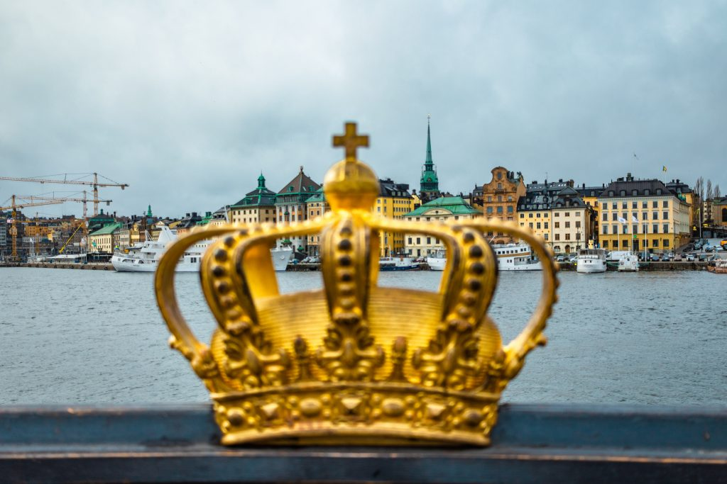 golden crown with views of gamla stan across the water